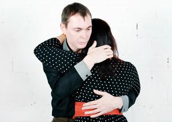Man comforting his woman
