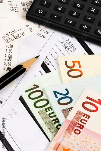 Euro, calculator, expenses and pencil