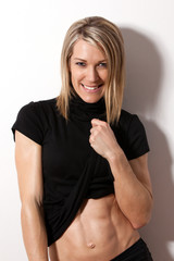 Young attractive fit woman smiling
