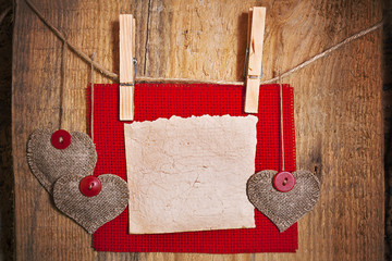 Decoration on Wooden background with fabric Heart and blank card