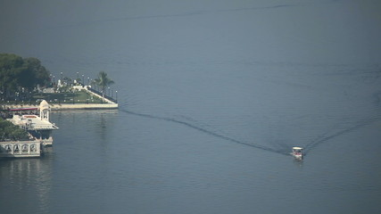 Small boat moving past the hotel on the lakein Jodhpur, India.