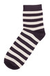 Black sock in a light yellow stripes