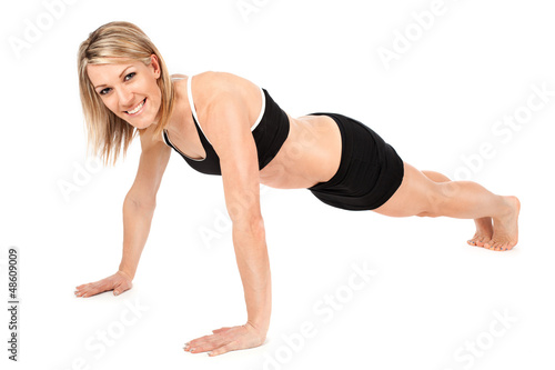 Beautiful fit young woman doing push ups