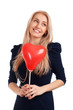 Young woman with heart shape balloons