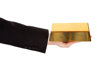 Businessman holding out a gold bar