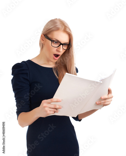 Shocked lady reading womens magazine