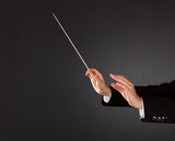 Music conductor with a baton