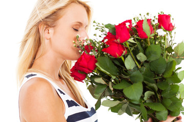 pretty young woman smelling bunch of roses