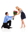young woman accepting roses from a man on valentine's day