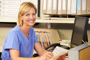 Portrait Of Nurse Working At Nurses Station
