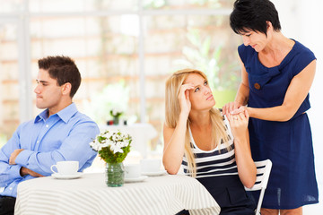 caring mother standing by her daughter has marriage problem