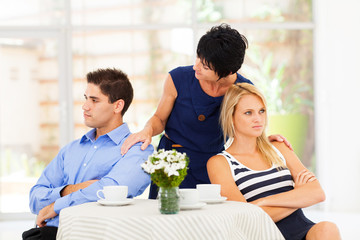 caring mother reconciling fighting young couple