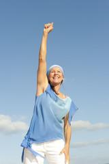 Positive mature woman outdoor winner