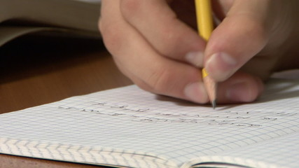 School Teen writing mathematic formulas