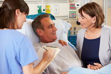 Nurse Talking To Couple On Ward