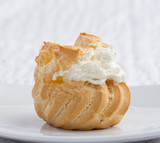 Big eclair appetizer looks eatable with mousse cream on dish poster