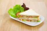 Clean and eatable ham sandwich with vegetables on the wooden kit poster