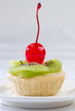 Sweet kiwi and cherry fruity tart confection snack ready made fr poster