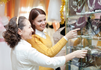 women  chooses bridal accessories at store
