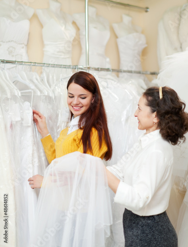 Two women  at wedding store