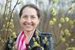 mature woman in spring pussywillow plant