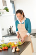 Woman cutting vegetables kitchen standing happy