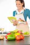 Happy woman preparing recipe vegetables cooking kitchen poster