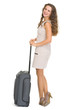 Happy young woman with wheels suitcase