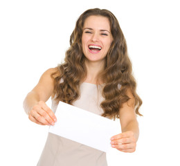 Happy young woman giving envelope
