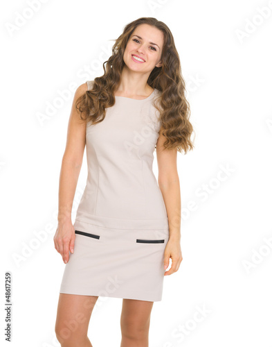 Portrait of happy young woman in dress