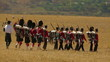 Kilties marching to a battle during a combat demonstration