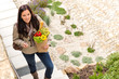 Young woman arriving home groceries shopping smiling