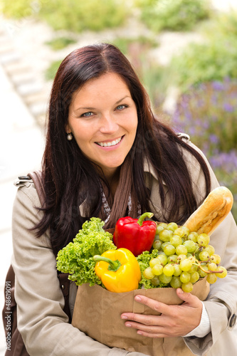 Smiling woman shopping vegetables groceries paper bag