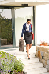 Young businesswoman rushing luggage going busy traveling