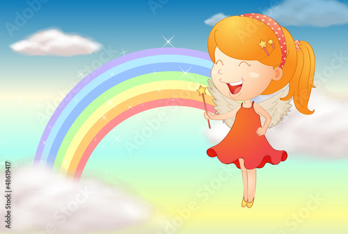 An angle girl and a rainbow