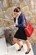 Traveling businesswoman hurried rushing climbing baggage carry-o