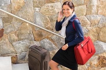 Smiling woman talking phone business traveling rushing