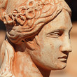 detail of classic clay sculpture with female face profile, Tusca