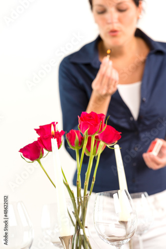Woman setting table romantic dinner roses Valentine's