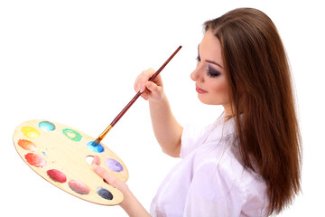 beautiful young woman painter with brushes and  palette,
