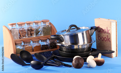 composition of kitchen tools,spices and cook book