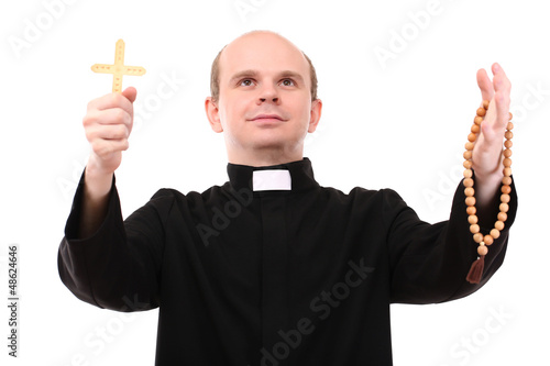 Young pastor with wooden cross and  rosary, isolated on  white