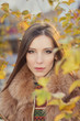 portrait of a beautiful girl in autumn leaves