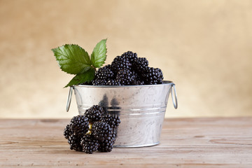 Small bucket with fresh blackberries