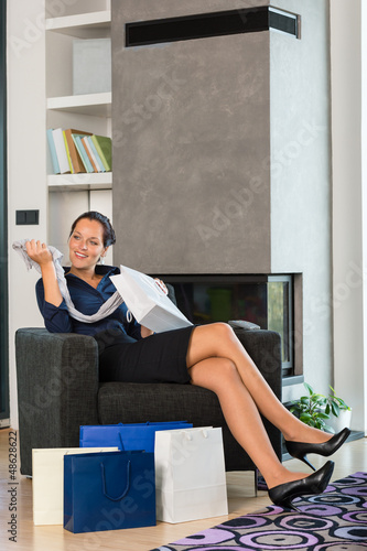 Woman looking clothes gift sale living room