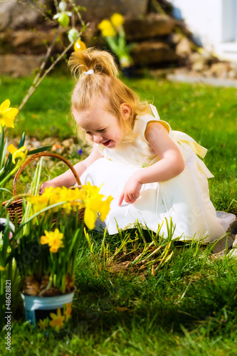 Girl on Easter egg hunt with eggs