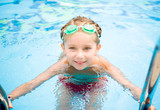 Little girl in swimming pool