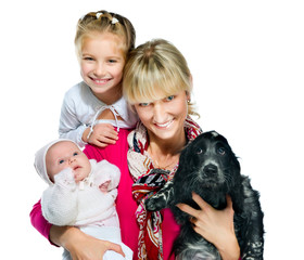 Pretty young woman with her daughters and dog