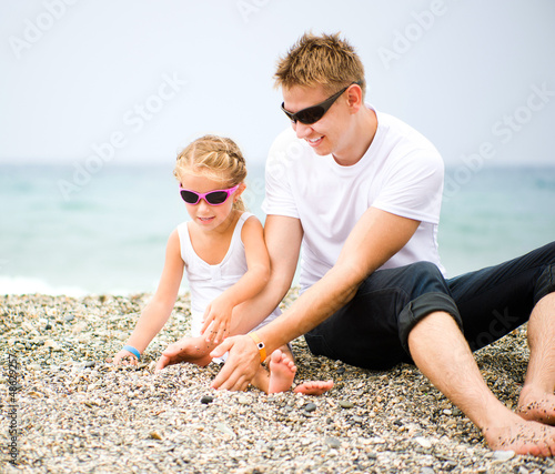 father and his daughter on the beach