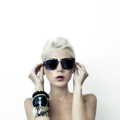 portrait of beautiful blond woman in fashionable glasses